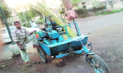 A three-wheeler 'Jugaad' being used by a sugarcane juice vendor.