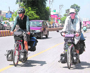 Two foreigners enjoy a bicycle ride on the Chakrata Road in Dehradun on Tuesday.
