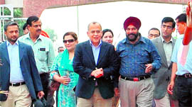 Pakistan Foreign Secretary Salman Bashir (fourth from left) crosses over to India at the Attari checkpost on Monday.