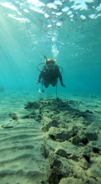 A diver explores the underwater city