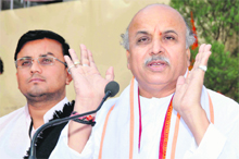Praveen Togadia, international general secretary of VHP, addresses a press conference in Dehradun on Tuesday.