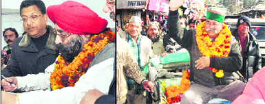 Devender Sethi, Congress candidate from Dehradun Cantt, files nomination papers in Dehradun on Wednesday; and (right) Jot Singh Gunsola, Congress legislator from Mussoorie, goes on a rickshaw to file nomination papers in Mussoorie
