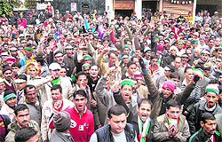 Congress supporters raise slogans in support of the party candidate from Dhanaulti at Nainbagh on Saturday