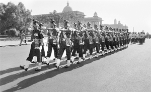 Soldiers march past South Block in New Delhi. All references in the final Act to Group-A officers should also apply to Commissioned Officers, while those to Group-B and Group-C staff should be applicable to Junior Commissioned Officers and Other Ranks respectively.