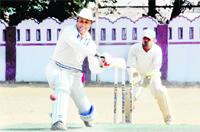 A batsman in action in a match in the 60th Dehradun District Cricket League Tournament in Dehradun on Thursday.