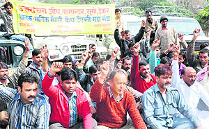 Members of the four-wheeler union of Haridwar hold a protest on Saturday