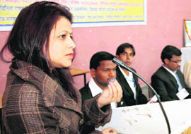 A member of the Legal Studies and Services Society, Uttarakhand, addresses a gathering at DAV PG College in Dehradun on Sunday.