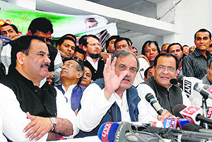 Birender Singh, Congress general secretary and in charge of state affairs, addresses a press conference in Dehradun on Friday.