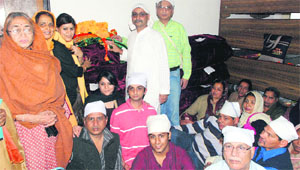 Dr Arun Dhup, a resident of Delhi, along with members of his family, who offered Darshani cover at Guru Ram Rai Darbar in Dehradun on Monday.