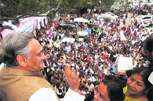 Chief Minister Vijay Bahuguna greets supporters at Congress Bhavan in Dehradun on Wednesday.