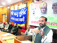 Senior BJP leader Ravinder Jugran addresses a gathering on Balidan Divas in Mussoorie