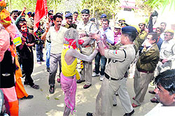 The police stops people from entering Maa Chamunda Devi temple situated in the Rajaji National Park in Haridwar on Friday