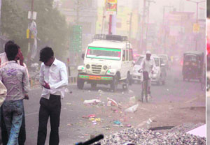 People caught in dust storm that lashed Haridwar on Wednesday.