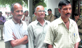 Members of Rajesh Rawat's family, who was killed in the firing, after the pronouncement of the judgment.