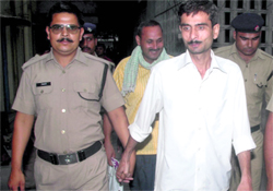 Convicted policemen in civvies.