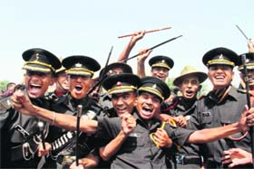 Gentlemen cadets of the Indian Military Academy rejoice after the passing-out parade in Dehradun on Saturday