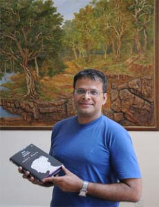 Jerry Pinto with his book Em and the Big Hoom