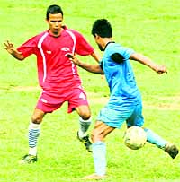 Players in action at the 3rd ONGC BS Negi Memorial Football Tournament in Dehradun on Wednesday