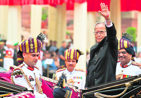 President Pranab Mukherjee waves from his horse-drawn carriage at Rashtrapati Bhawan after his swearing-in ceremony on Wednesday.