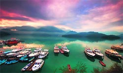 The aquamarine Sun Moon Lake in the centre of the island, ringed by green hills, is like a magical lost land, straight out of a fairytale