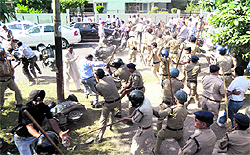The police lathi-charge BJP and Congress workers after they clashed for the possession of property in the Race Course locality in Dehradun on Thursday