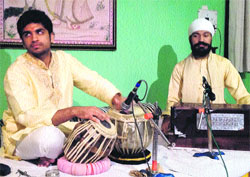 Artistes perform during a musical baithak held at Gurukul Viram in Dehradun on Monday.