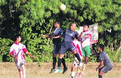 A match in progess in the Shaheed Jaideep Bhandari Memorial Football Tournament being played at Nehru Gram in Dehradun on Monday.