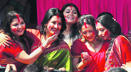 Tollywood actresses take part in 'Sindur Khela' on Doshomi at a Durga Puja pandal in Kolkata on Sunday