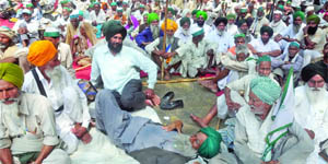 Farmers stage a sit-in for their demands at Parliament Street in New Delhi on Wednesday.