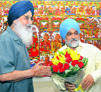 Chief Minister Parkash Singh Badal greets Montek Singh Ahluwalia, Deputy Chairman, Planning Commission in New Delhi on Tuesday.
