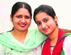 Arshdeep Kaur Batth, who has topped Mohali district, with her mother. - chd1