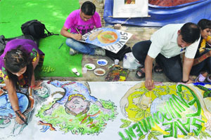 Artists From The Health Education And Environment Awareness Society Make Paintings On Roadside