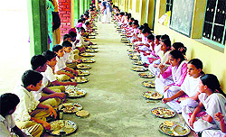 Students of Govt School work for their self during MID DAY MEAL