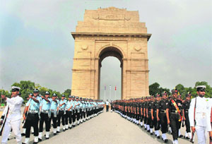 Inter-Services personnel march near Amar Jawan Jyoti at India Gate during a ceremony to pay homage to Kargil war martyrs on the occasion of