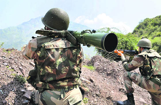 Army soldiers take positions during an encounter with militants at Tangdar area in Kupwara district.