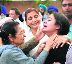 ... ) the deceased couple's inconsolable daughter. Photos: Vishal Kumar