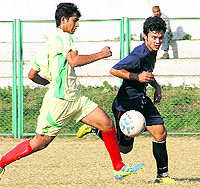 Players in action in a match in the Dehradun District Football Super League played at Pavillion Ground in Dehradun on Wednesday