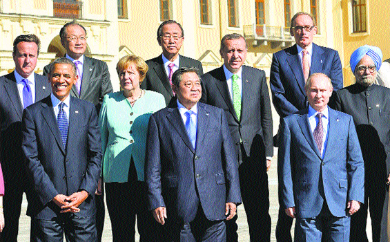 (From top L) British Prime Minister David Cameron, World Bank President Jim Yong Kim, United Nations (UN) Secretary General Ban Ki-moon, Turkey's Prime Minister Recep Tayyip Erdogan, Australia's Foreign Minister Bob Carr, India's Prime Minister Manmohan Singh and (from bottom L) US President Barack Obama, Germany's Chancellor Angela Merkel, Indonesia's President Susilo Bambang Yudhoyono and Russia's President Vladimir Putin pose at the G20 summit in Saint Petersburg.