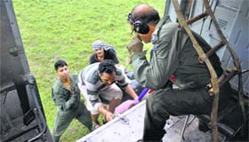 IAF personnel rescue people from flood-affected regions of Akhnoor in Jammu on Friday.